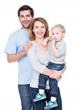 Portret van de gelukkige familie met weinig baby. Stock Foto's