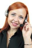 Portret van de gelukkige glimlachende vrolijke exploitant van de steuntelefoon in hoofdtelefoon Stock Foto's