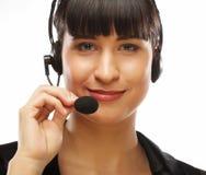 Portret van de glimlachende arbeider van de klantenondersteunings vrouwelijke telefoon, over w Royalty-vrije Stock Fotografie