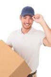 Portret van de glimlachende jonge leveringsmens Stock Foto