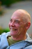 Portret van de glimlachende oude mens Stock Foto