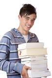Portret van de jonge, knappe boeken van de studentenholding Royalty-vrije Stock Foto's