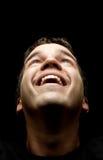 Portret van de jonge mens die kijkt die omhoog op zwarte wordt geïsoleerda Royalty-vrije Stock Foto's