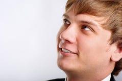 Portret van de jonge mens op grijs Royalty-vrije Stock Afbeeldingen