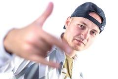 Portret van de jonge mens in sporthoed Stock Foto's