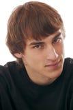 Portret van de knappe glimlachende tiener jonge mens Royalty-vrije Stock Foto's