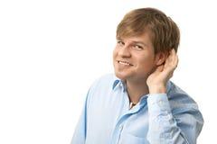 Portret van de luister jonge mens stock afbeeldingen