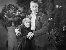 Portret van de mens met bejaarde grootmoeder (Alle afgeschilderde personen leven niet langer en geen landgoed bestaat Th van leve Royalty-vrije Stock Fotografie