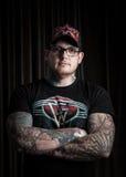 Portret van de mens met tatoegering Stock Foto