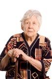 Portret van de oude vrouw die op wit wordt geïsoleerdd Stock Foto's