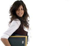 Portret van de studiemateriaal van de studentholding Royalty-vrije Stock Foto's