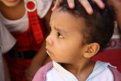 Portret van dichte omhooggaand van het jongensgezicht bij liefdadigheidsgebeurtenis in giza, Egypte Stock Fotografie