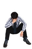 Portret van droevige zakenmanzitting op de vloer Stock Foto's