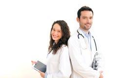 Portret van een arts met zijn verpleegster Stock Afbeelding