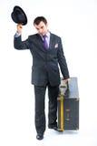 Portret van een bedrijfsmens met grote oude koffer Stock Foto
