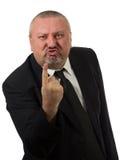 Portret van een boze midden oude zakenman die in kostuum op u richten royalty-vrije stock foto
