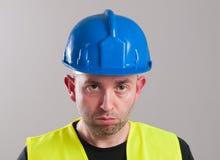 Portret van een droevige arbeider Stock Foto's