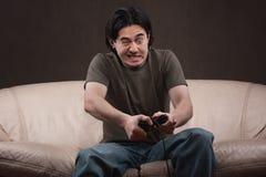 Portret van een gekke gamer Stock Afbeelding