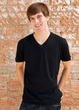 Portret van een gelukkige jonge mens. Stock Fotografie