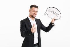 Portret van een gelukkige rijpe zakenman gekleed in kostuum Stock Afbeeldingen