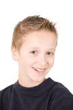 Portret van een glimlachende jonge jongen Stock Afbeeldingen