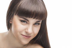 Portret van een het Glimlachen Jong Brunette met Lang Recht haar Royalty-vrije Stock Afbeeldingen