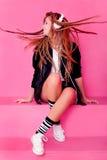Portret van een jong meisje met hoofdtelefoon Stock Foto