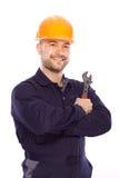 Portret van een jonge bouwer met de hulpmiddelen Royalty-vrije Stock Afbeeldingen