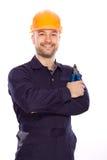 Portret van een jonge bouwer met de hulpmiddelen Royalty-vrije Stock Foto's