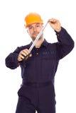 Portret van een jonge bouwer met de hulpmiddelen Royalty-vrije Stock Afbeelding