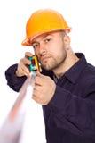 Portret van een jonge bouwer met de hulpmiddelen Stock Fotografie