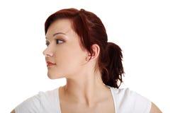 Portret van een jonge vrouw die linker kijkt Stock Foto