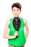 Portret van een jonge vrouw met een zwart masker in zijn hand royalty-vrije stock fotografie