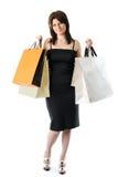 Portret van een jonge vrouw met pakketten van winkel Stock Foto