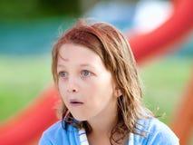 Portret van een Jongen met Blond Lang Haar in Blauw Stock Afbeelding