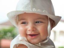 Portret van een kind een paar maanden op de dag van haar doopsel royalty-vrije stock afbeelding