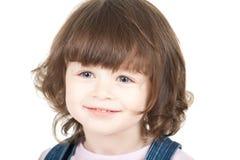Portret van een klein glimlachend meisje Stock Afbeeldingen