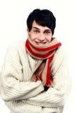 Portret van een knappe mens gekleed voor het koude de winter glimlachen. Jonge mens het bevriezen. Royalty-vrije Stock Foto's