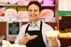 Kruidenier op het werk Stock Foto