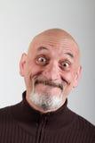 Portret van een mens met grappige gelaatsuitdrukkingen Stock Fotografie