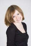 Portret van een mooi glimlachend tienermeisje Stock Fotografie