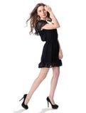 Portret van een mooi meisje in een weinig zwarte kleding royalty-vrije stock afbeeldingen