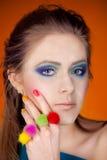Portret van een mooi meisje met een heldere make-up Stock Foto's