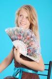 Portret van een mooi meisje met ventilator Stock Afbeelding