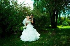 Portret van een mooie bruid en een bruidegom Stock Fotografie