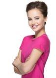 Portret van een mooie jonge gelukkige glimlachende vrouw stock foto's