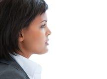 Portret van een peinzende bedrijfsvrouw op het werk Stock Afbeelding