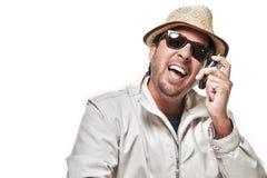 Portret van een reizigersmens die op de telefoon spreekt Stock Fotografie