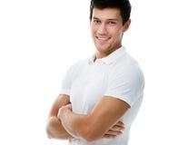 Portret van een sportieve mens met gekruiste wapens Stock Foto's