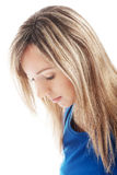 Portret van een vrouw die neer kijkt. Stock Foto